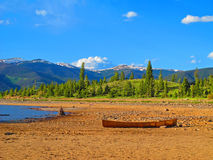 Tranquil Eve. The sun sets on Lake Dillon, casting a beautiful orange glow on the beach and nearby boats- Frisco, Colorado Royalty Free Stock Images