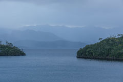 Tranquil evening on Lake Pedder with beautiful hills silhouetted Stock Photography