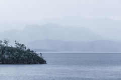 Tranquil evening on Lake Pedder with beautiful hills silhouetted Stock Image