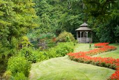 Tranquil Garden. With gazebo and pond Royalty Free Stock Image