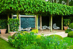 Tranquil garden landscape. With a patio area Royalty Free Stock Photos