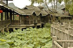 Tranquil Garden near Guilin. A tranquil floating garden in Southern China with a rambling house and pathway Stock Photos