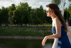 Tranquil girl in rays of evening sun Royalty Free Stock Photo
