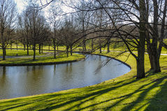 Tranquil Green Parc Area with Water Area Royalty Free Stock Images