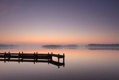 Tranquil, jetty sunrise Stock Photo