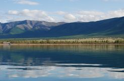 Tranquil lake and mountains Stock Photos