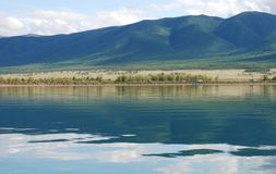 Tranquil lake and mountains Stock Photo