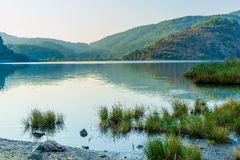 Tranquil lake in the mountains Stock Photos