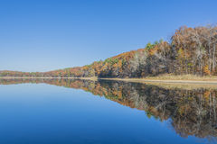 Tranquil Lake With Rust Colored Fall Scenery Stock Image
