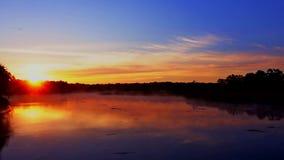 Tranquil lake sunrise fog. Sunrise on the lake, sunrise over river, morning Landscape tranquil lake sunrise fog stock video footage