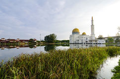 Tranquil lake surrounded As-Salam Mosque located in Selangor, Malaysia. With reflection on the lake Stock Images