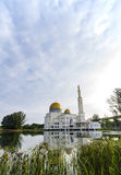 Tranquil lake surrounded As-Salam Mosque located in Selangor, Malaysia. With reflection on the lake Royalty Free Stock Photo