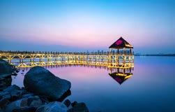 Wooden trestle bridge. Tranquil lake and wooden trestle, evening landscape Stock Photo