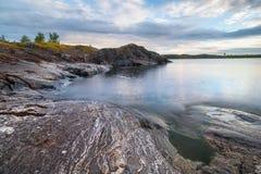 Landscape of stony coast of the lake Royalty Free Stock Images