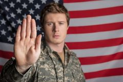 Tranquil male soldier is proud of his country stock photo