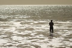 Tranquil. Man enjoying tranquil water scenery Stock Photo