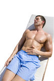 Tranquil man laying on lounge chair sunbathing.  stock image