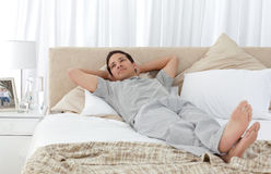 Tranquil man lying on his bed Royalty Free Stock Photography