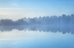 Tranquil misty morning on lake Stock Photo