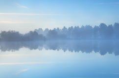 Tranquil misty morning on lake Stock Photo