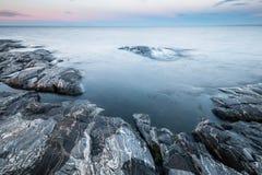 Tranquil morning minimalist landscape of stony coast Royalty Free Stock Images
