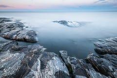 Tranquil morning minimalist landscape of stony lake coast Royalty Free Stock Photos
