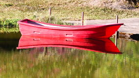 Tranquil morning red canoe on lake, HD 1080P stock footage