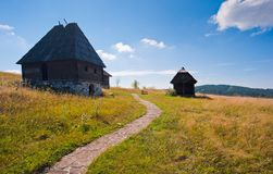 Tranquil mountain cottages in summer Stock Photo