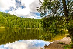 Tranquil mountain lake with reflections stock photography