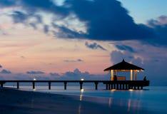 Tranquil Ocean in the twilight. Bridge silhouette and tranquil ocean in the twilight Stock Images