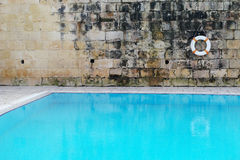Tranquil Old Swimming Pool with Clear Water Stock Photography
