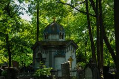 Tranquil orthodox chapel in graveyard, Moscow spring time stock photography