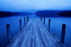 Tranquil Peaceful Lake With Blue Jetty Stock Photos