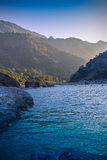 Tranquil and peaceful nature background of beautiful river ganges stream flowing through natural cascades in Rishikesh India. royalty free stock photography