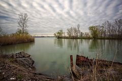 A tranquil place, a blue lagoon under a cloudy sky. In Windsor, Ontario Canada Stock Photo