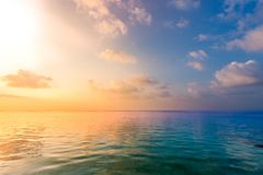 Relaxing and calm sea view. Open ocean water and sunset sky. Tranquil nature background. Infinity sea horizon stock image