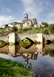 Tranquil River. A Quaint and Historic Riverside Village in France Royalty Free Stock Photo
