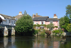 Tranquil River Scene. Old bridge and houses on riverbank in Christchurch Dorset Royalty Free Stock Images