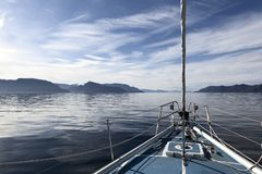 Tranquil sailing in Norwegian fjords Stock Photography