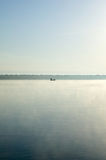 Tranquil scene of boat in calm lake. Tranquil scene of boat in calm water of Panasoffkee Lake, Florida, USA Royalty Free Stock Image