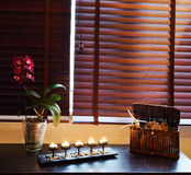 Spa Treatment. Tranquil scene of candles, orchids and spa accessories Stock Images