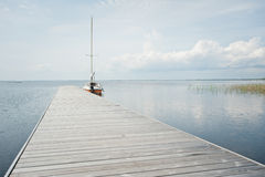 Tranquil scene with and lake. Sailing boat parked at dock, vacation, lake Stock Images