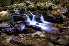 Tranquil scene with mountain creek and watefalls stock photo
