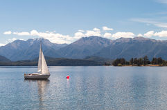 Tranquil scene of a sailboat on a lake Royalty Free Stock Images