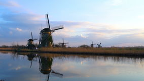 Tranquil scene of windmills at dusk. In Kinderdijk, Netherlands 4K Ultrahd stock video footage