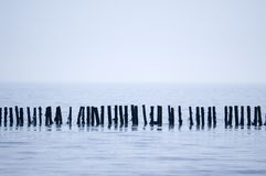 Tranquil sea. Sea defences at Mersey beach, Suffolk, UK royalty free stock image