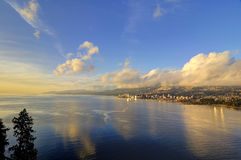 Tranquil sea Inlet and mountains with clouds at winter sunset time Stock Photography