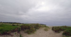 Tranquil secluded sand dunes. On a cloudy day stock video