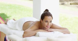 Tranquil spa customer relaxes on table stock video footage