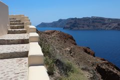 Tranquil Stairs climbing up from Aegean Sea in Santorini Island, Greece. stock photos